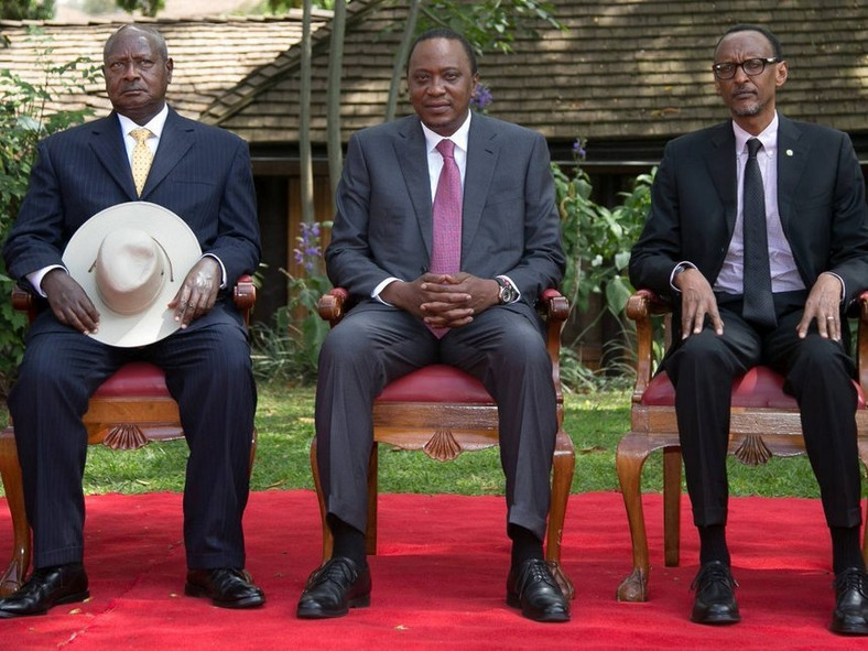 Presidents Yoweri Museveni, Uhuru Kenyatta and Paul Kagame pose for a photo