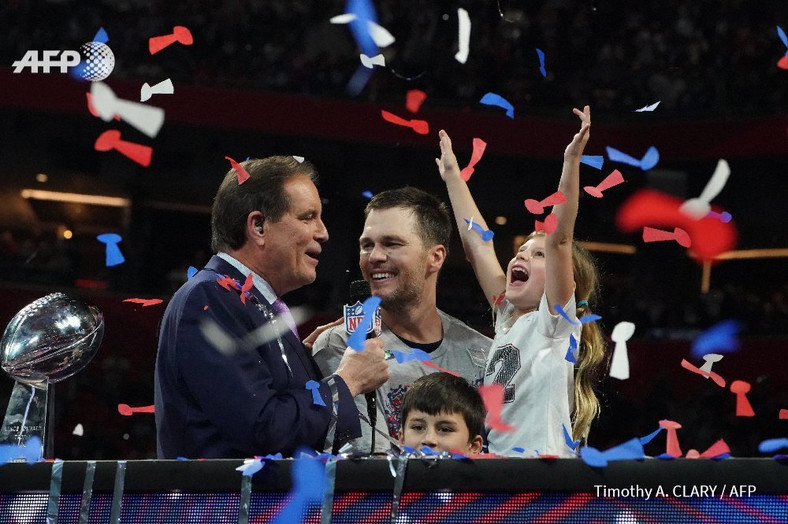 Tom Brady celebrates with his daughter after the win (Timothy A. Curry/AFP)