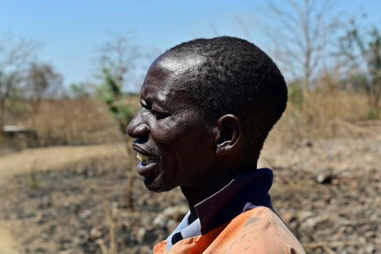 Sinos Mlauzi, a black Zimbabwean who used to work for a white farmer who was evicted under ex-leader Robert Mugabe, still has scars from the violence