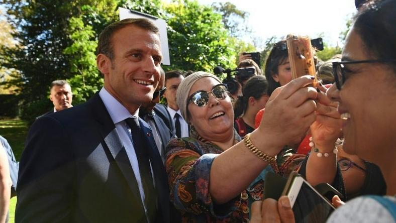Emmanuel Macron with visitors attending the open house at the Elysee Palace on Saturday during France's Heritage Days