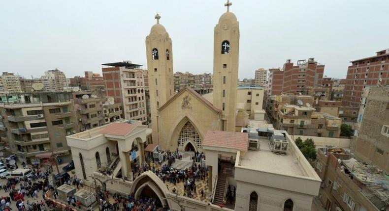A general view shows people gathering outside the Mar Girgis Coptic Church in the Nile Delta City of Tanta, 120 kilometres (75 miles) north of Cairo, after a bomb blast struck worshippers gathering to celebrate Palm Sunday on April 9, 2017