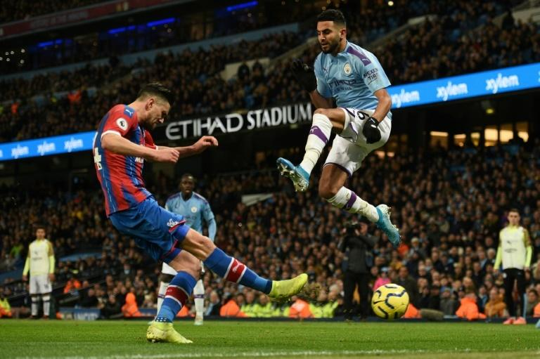Algerian midfielder Riyad Mahrez (R) sparked Manchester City's performance but they could only draw 2-2 with Crystal Palace