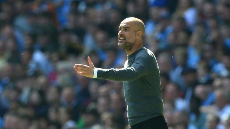 Pep Guardiola gestures during Manchester City's vital win over Tottenham