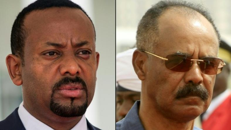The file picture combo shows Ethiopia's Prime Minister Abiy Ahmed (L) and Eritrean President Isaias Afwerki. The two are holding a historic meeting in Asmara to try to restore relations between the two neighbours