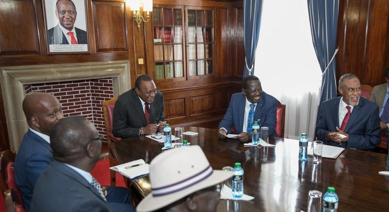 President Uhuru Kenyatta and Raila Odinga at a past meeting with a section of the Building Bridges Initiative team