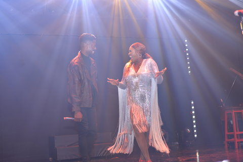 Waje on stage with Johnny Drille at Red Velvet concert