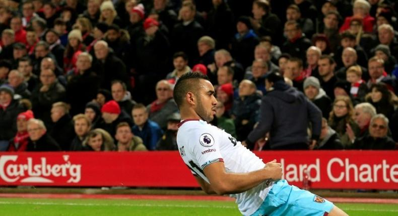 West Ham United's midfielder Dimitri Payet celebrates after scoring their first goal against Liverpool, north west England on December 11, 2016
