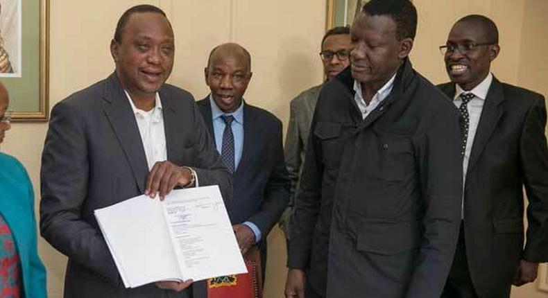 President Uhuru Kenyatta with his legal team including Evans Monari (back right)