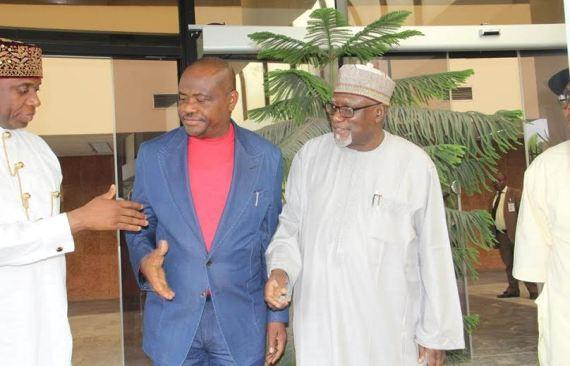 Nyesom Wike and Rotimi Amaechi exchange handshake after the peace meeting on Tuesday, July 26.