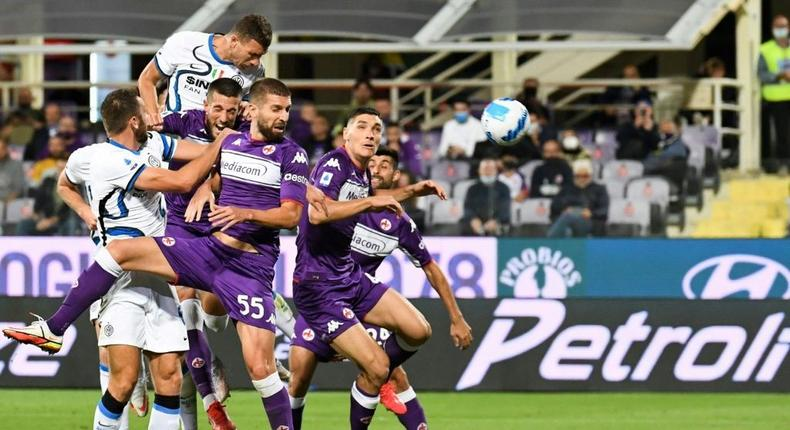 Edin Dzeko (L) has scored four goals for Inter Milan after nodding them in front at Florence Creator: ANDREAS SOLARO