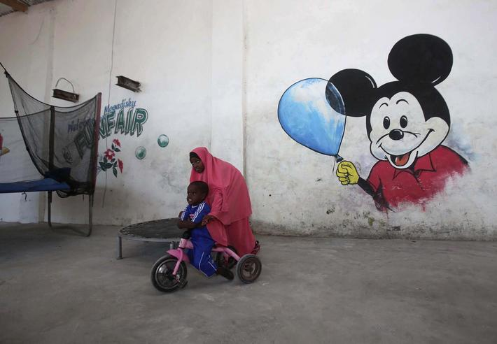 Children play at a guest hotel in Mogadishu October 10, 2013. Street lamps now brighten some of Moga