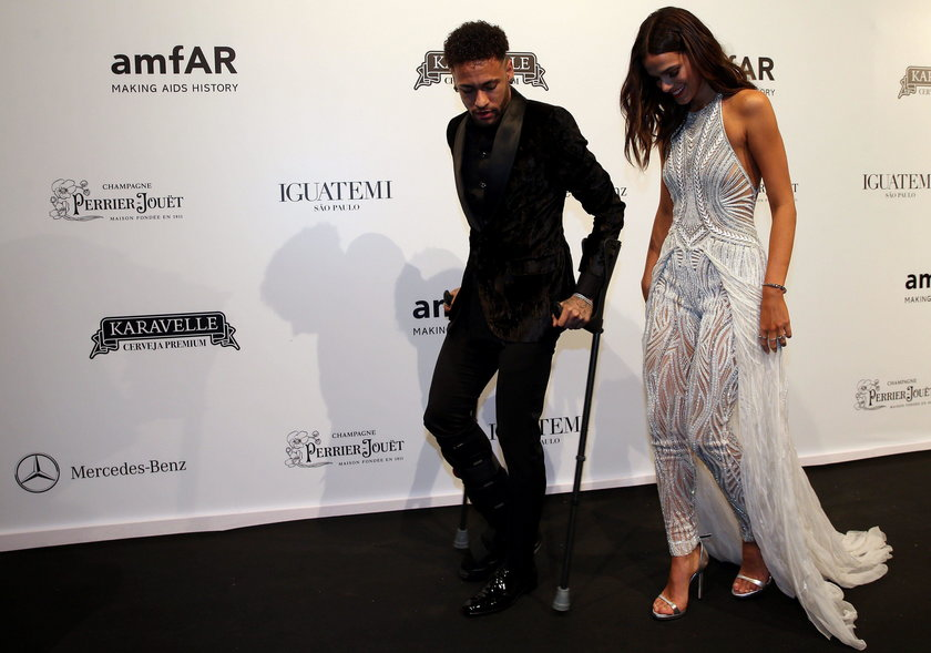 Soccer player Neymar and his girlfriend Bruna Marquezine arrive at the eighth annual amfAR Gala Sao