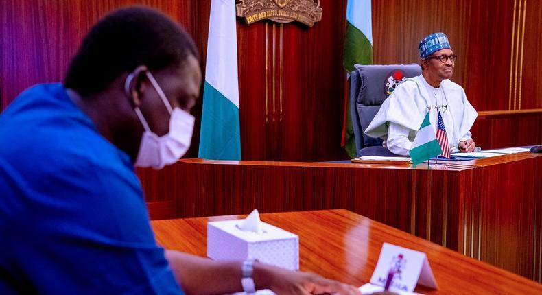 Femi Adesina (left) and President Muhammadu Buhari (right) [Presidency]