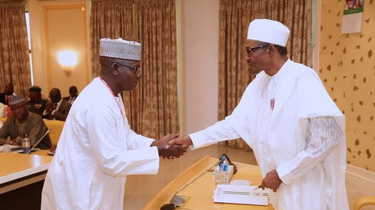 President Muhammadu Buhari in a handshake with Alh Mohammed Nami during the Inauguration of Audit Committee on Recoveries at the State House in Abuja, November 2017.