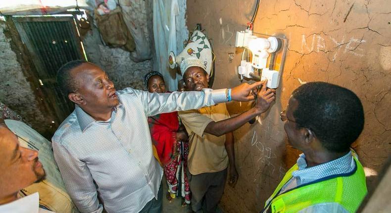 President Uhuru Kenyatta launching electricity at a Kenyan home