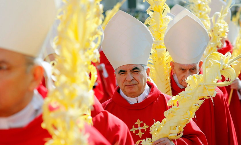 Cardinal Angelo Becciu arrives for the Palm Sunday Mass led by Pope Francis in Saint Peter's Square, at the Vatican