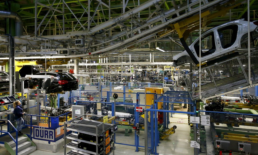 An employee of German car manufacturer Mercedes Benz observes the connection between the bodywork and the chassis of an A class (A-Klasse) model at their production line at the factory in Rastatt