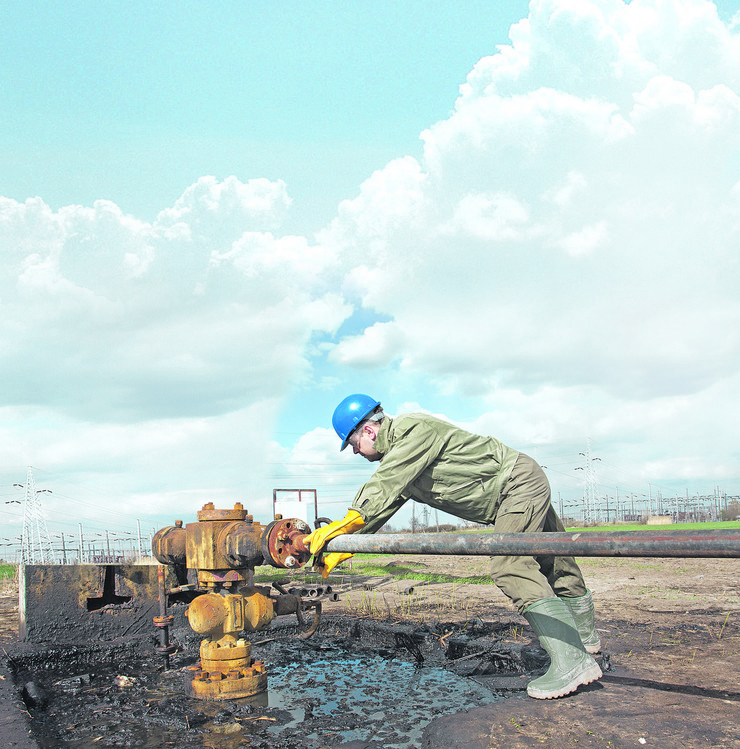 stock-photo-oil-worker-check-oil-pump-100283720