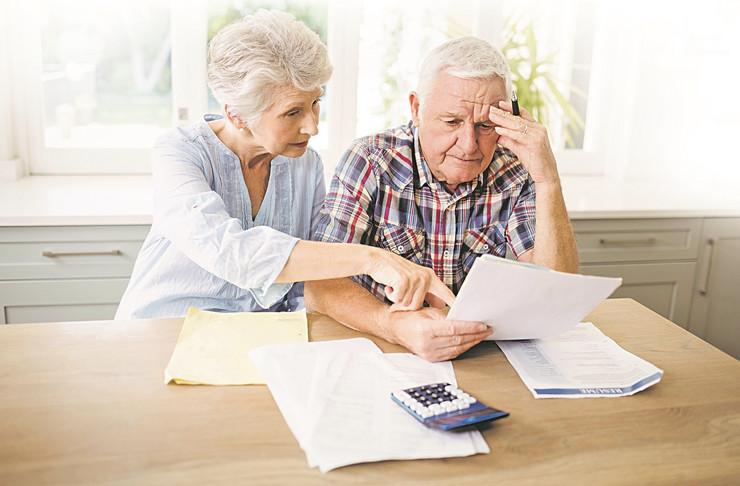 A worried-senior-couple-checking-their-450w-388566784