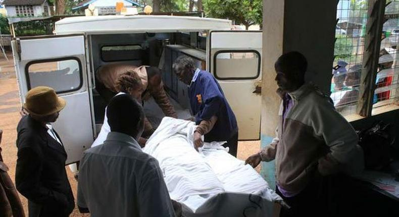 An accident victim, is carried into an ambulance at Karatina sub county hospital after hours of waiting without assistance on December 5, 2016 as doctors went on strike.