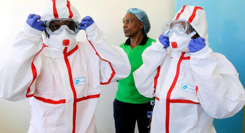 Kenyan medics during a demonstration of preparations for any potential coronavirus cases at the Mbagathi Hospital, isolation centre for the disease, in Nairobi