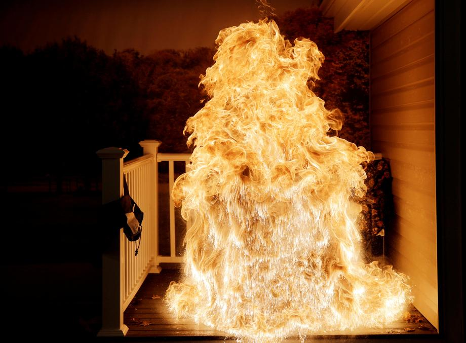 Frozen turkey is dropped into deep fryer and creates a large fireball at a food safety demonstration