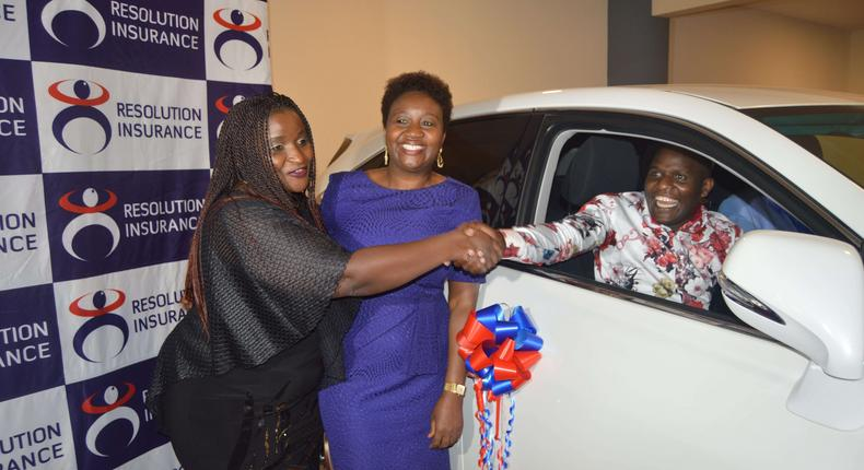 Damaris Ngare (L) congratulates Mr. Lameck Nyasetia of Platinum Micro-insurance Brokers as Resolution MD Ms. Alice Mwai (C) looks on. Platinum Micro-insurance Brokers scooped the overall winners prize (Lexus RX270) during the Resolution Agent Awards held on 15th March 2019 at the Movenpick Hotel Nairobi.