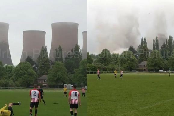 E, ovo se zove NEVIĐENO! Igrali su fudbal, a onda BUM! Odjednom su u pozadini nestali tornjevi nuklearne elektrane, a evo kako je to izgledalo! /VIDEO/