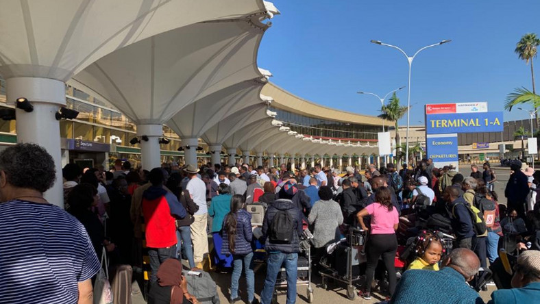 Kenya's Jomo Kenyatta International Airport grinds to halt after workers down tools, leaving a trail of injuries, arrests, tear gas and frustration