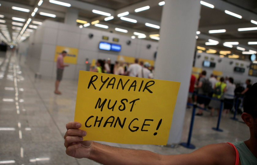 Ryanair employees show their shirts during a protest on the first day of a cabin crew strike held in