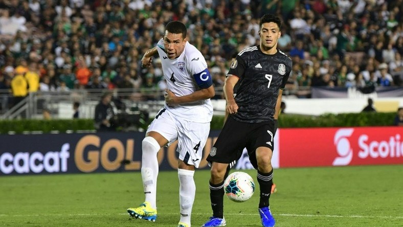 Cuba's Yasmani Lopez (L) vies for the ball with Mexico's forward Raul Jimenez (R) during their Concacaf Gold Cup match in California -- after which Lopez defected