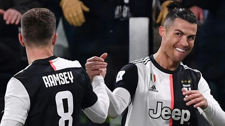 Juventus forward Cristiano Ronaldo (R) has scored in seven consecutive league games