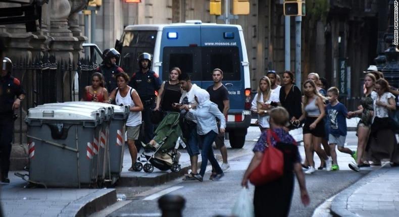 People flee the scene of the attack which occurred in Barcelona, Spain, on August 17, 2017.