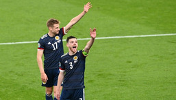 High fives: Scotland earned a 0-0 draw away to England to keep their Euro 2020 hopes alive Creator: FACUNDO ARRIZABALAGA