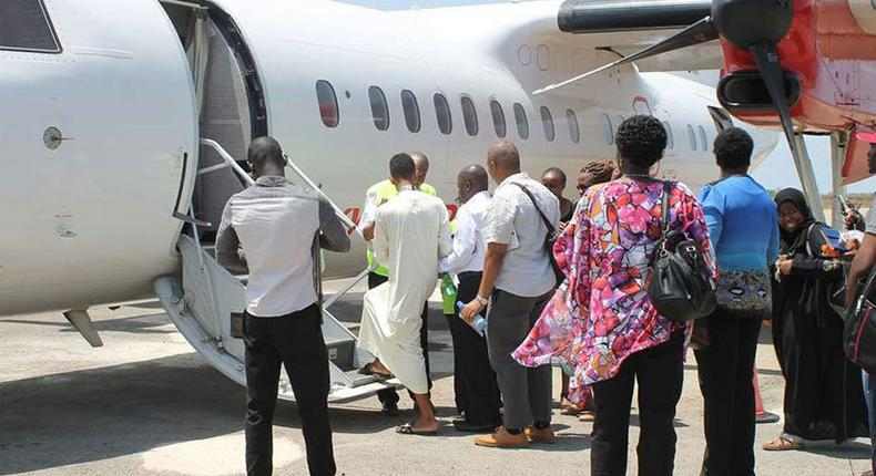 File image of passengers boarding a plane at Manda Airport