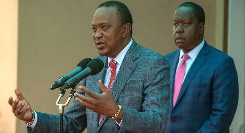 President Uhuru Kenyatta with CS Fred Matiang'i at a past event