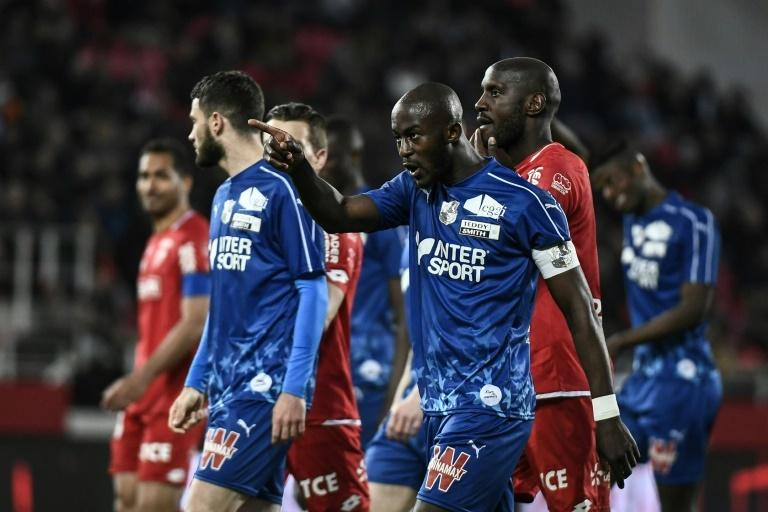 Amiens captain Prince-Desir Gouano points the finger after being targeted by racist abuse during his team's game against Dijon