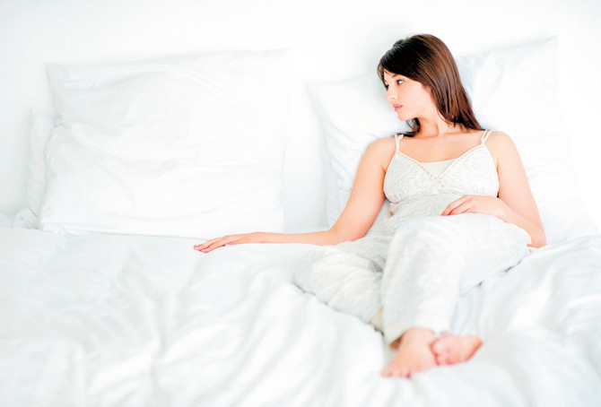 9479_stock-photo-portrait-of-a-sad-young-woman-missing-somebody-while-lying-on-bed-shutterstock_50487541
