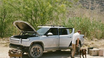 Rivian's R1T pickup has an air compressor, a built-in cooler under the bed, and a tailgate you can control through an app
