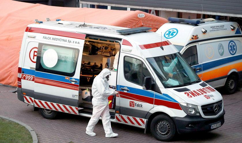 A paramedic walks near an ambulance amid the coronavirus disease (COVID-19) outbreak, in front of a