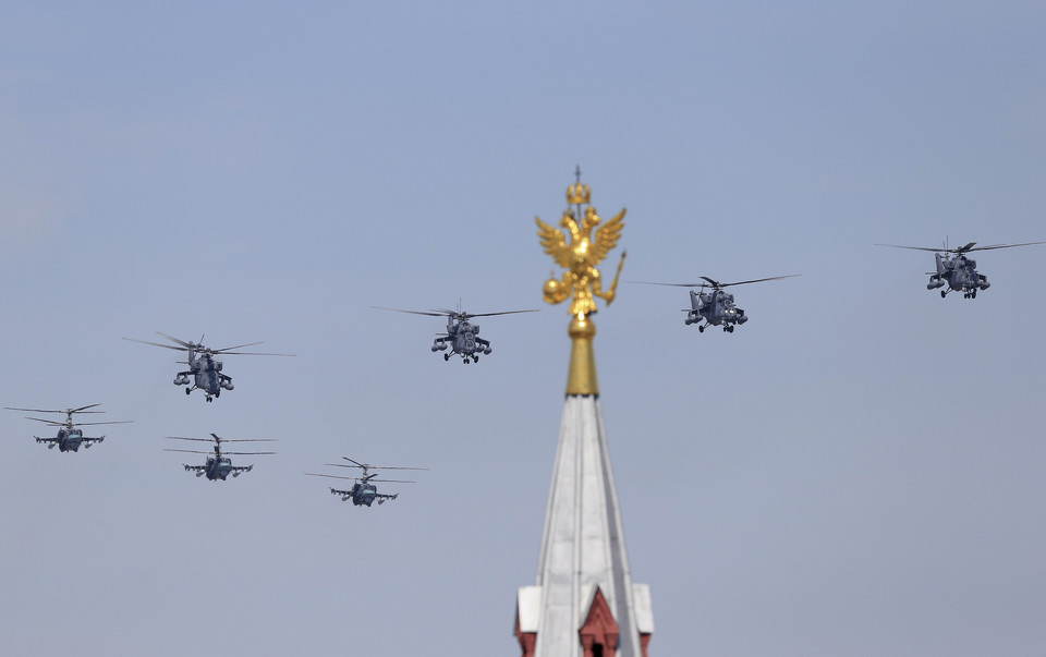 Russian Mil Mi-35 Hind helicopters fly in formation over the Red Square during the Victory Day parade in Moscow