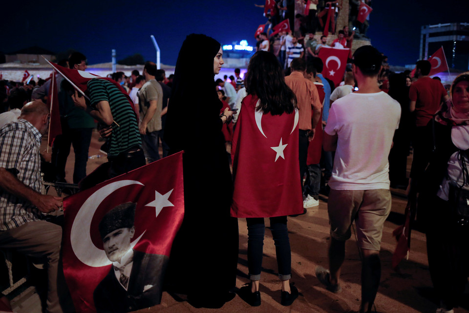 Supporters of Turkish President Tayyip Erdogan gather in Taksim Square during a pro-government demonstration in Istanbul