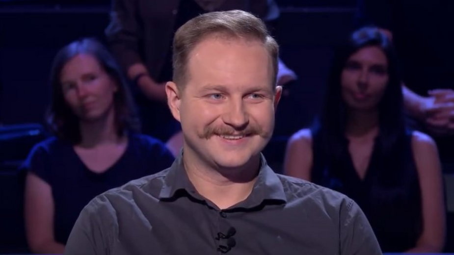 """Jacek Iwaszko w programie """"Milionerzy""""/kadr z programu"""