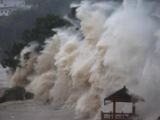 Waves brought by Typhoon Maria lash the shore in Wenzhou