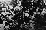 A Ustasa (Croatian fascist) guard stands amid corpses at the Jasenovac concentration camp, Yugoslavia, 1942 - Jevrejski istorijski muzej