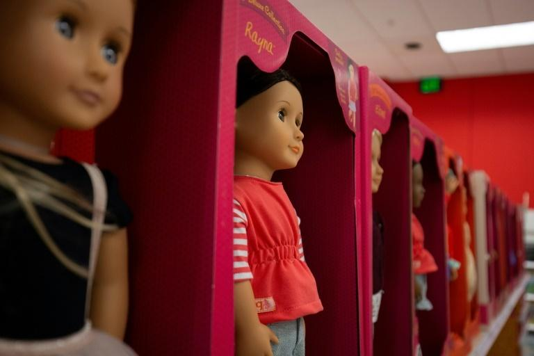 Toys made in China, such as these dolls sold at a store in the US capital, will likely see a price hike due to increased tariffs
