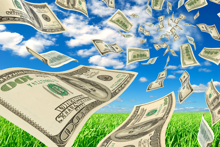 stock-photo-the-falling-cash-on-dollars-on-background-sky-and-herbs-130150823