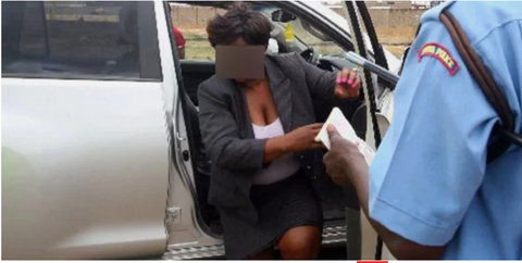 Police officers rain curses on a smart thief who snatched their bribe cash and fled into the bush