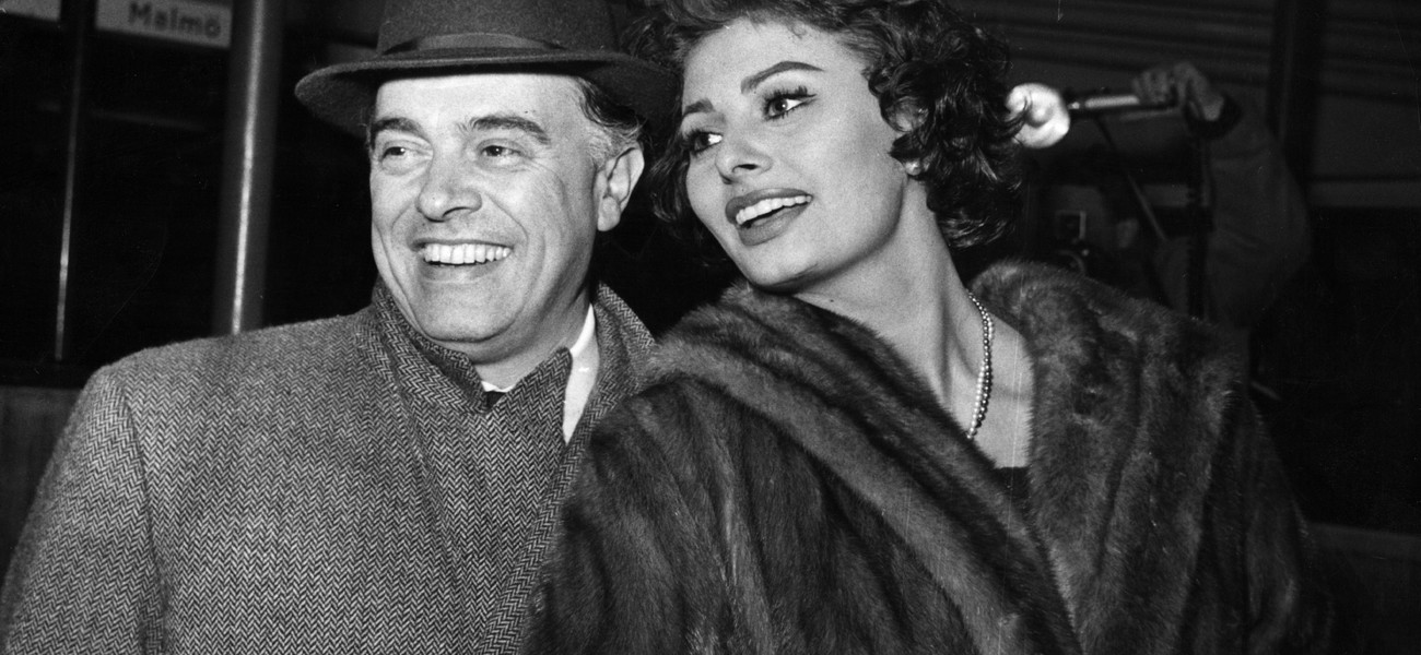 Carlo Ponti, the Italian film director and his wife Sophia Loren, the film actress arriving in Copenhagen en route from Rome to Los Angeles.They refused to comment on the rumour that Sophia was expecting a baby. January 23, 1958 GettyImages