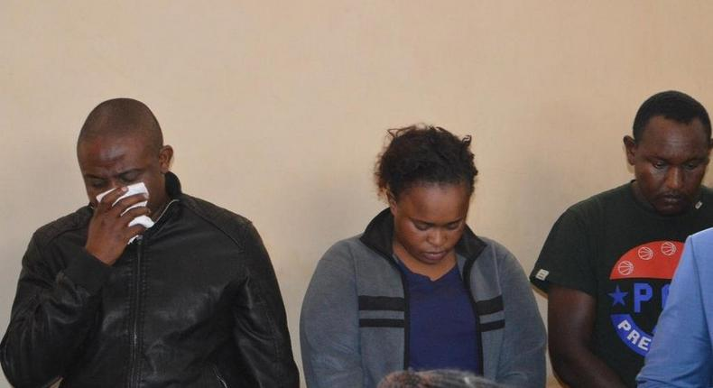 Joseph Kori wiping tears while in court with Judy Wangui and Micheal Mathenge in court